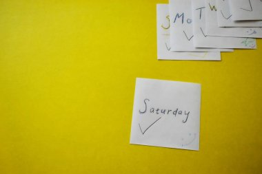 Paper stickers: days of the week in English.