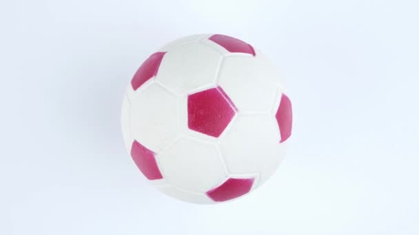 Fotbalový míč rotující na bílém pozadí. Mistrovství. Svět. Evropa. Místo pro text.