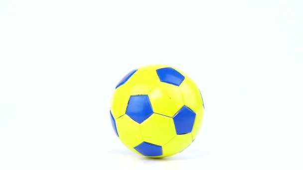 A focilabda fehér alapon forog. Foci. Bajnokság. Európába. Világot. Olimpia. Sport.