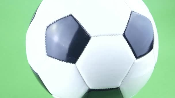 Soccer ball spinning on a green background. Football. Championship. Europe. World. Olympics. Sport.