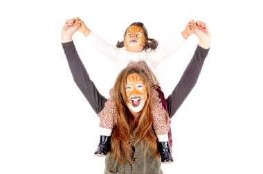 happy sisters painted as tigers
