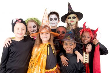kids posing  in costumes for halloween
