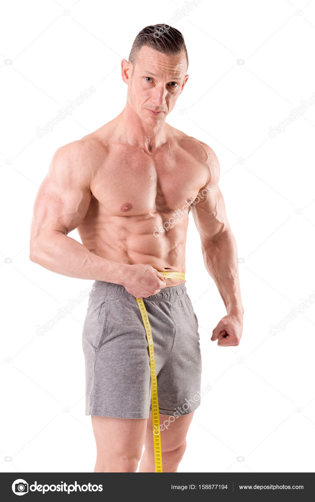 3d041b01e Homem de medir a espessura da cintura — Stock Photo © verkoka  158877194