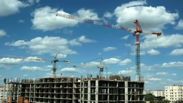 Time lapse builders and cranes working on the construction site
