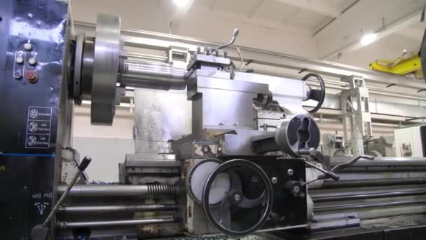 The lathe produces the metal part at the factory. Processing of the workpiece on a lathe. Working metal lathe. Heavy industry mechanical equipment. Slider