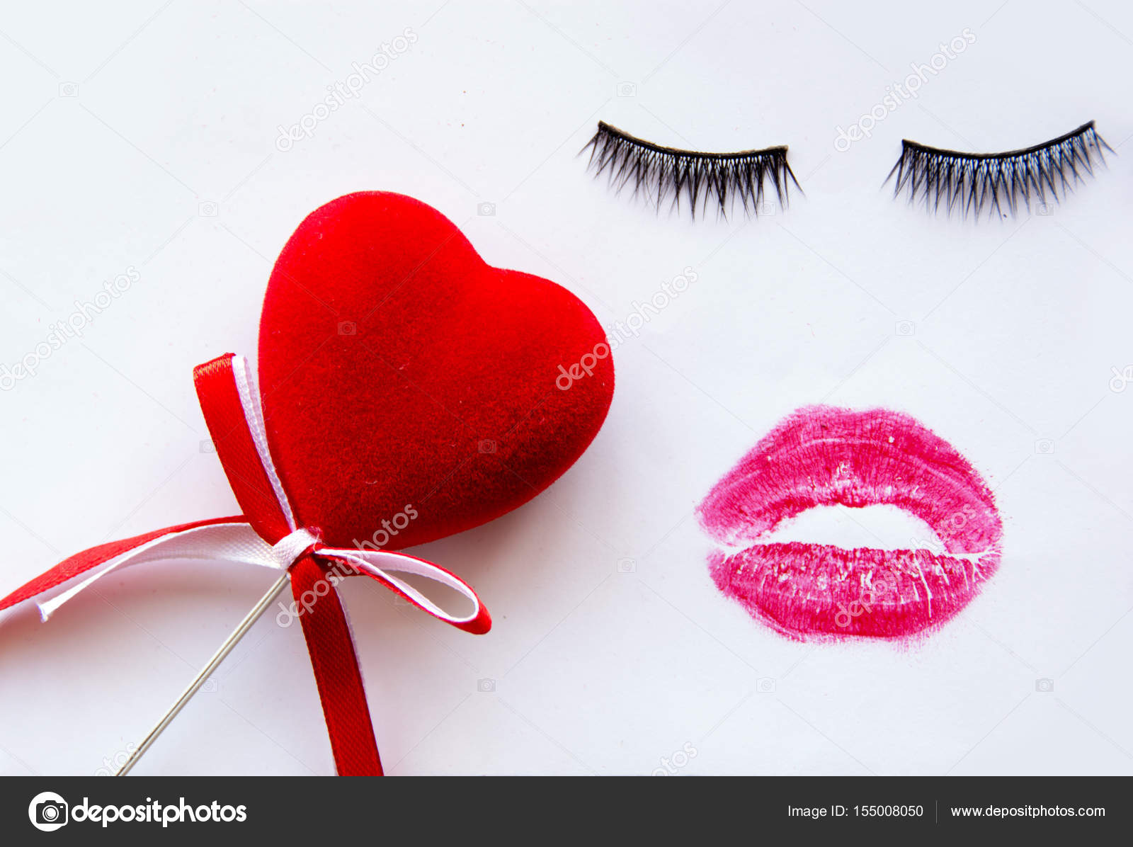 Red Heart False Eyelashes And Red Lipstick Kiss On White Background