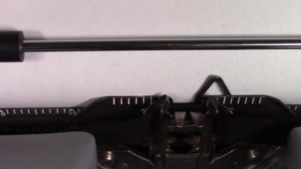 A close up video of the words Russian 101  being typed on white paper in an old manual typewriter. Shot in macro.