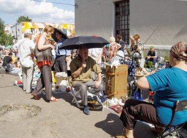 Flea market seller on a hot day