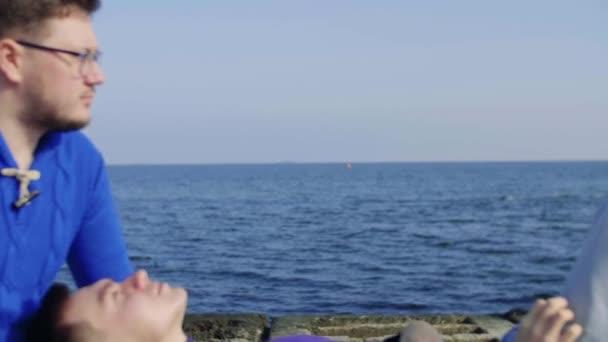 two gay sit at sea