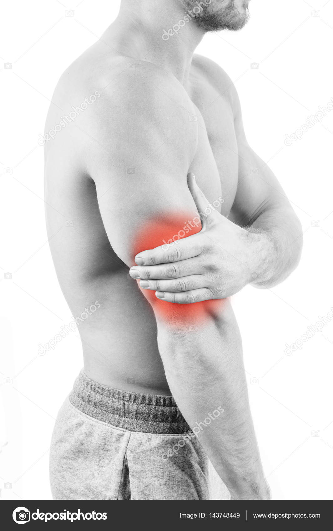 Man With Triceps Pain Over White Background Stock Photo