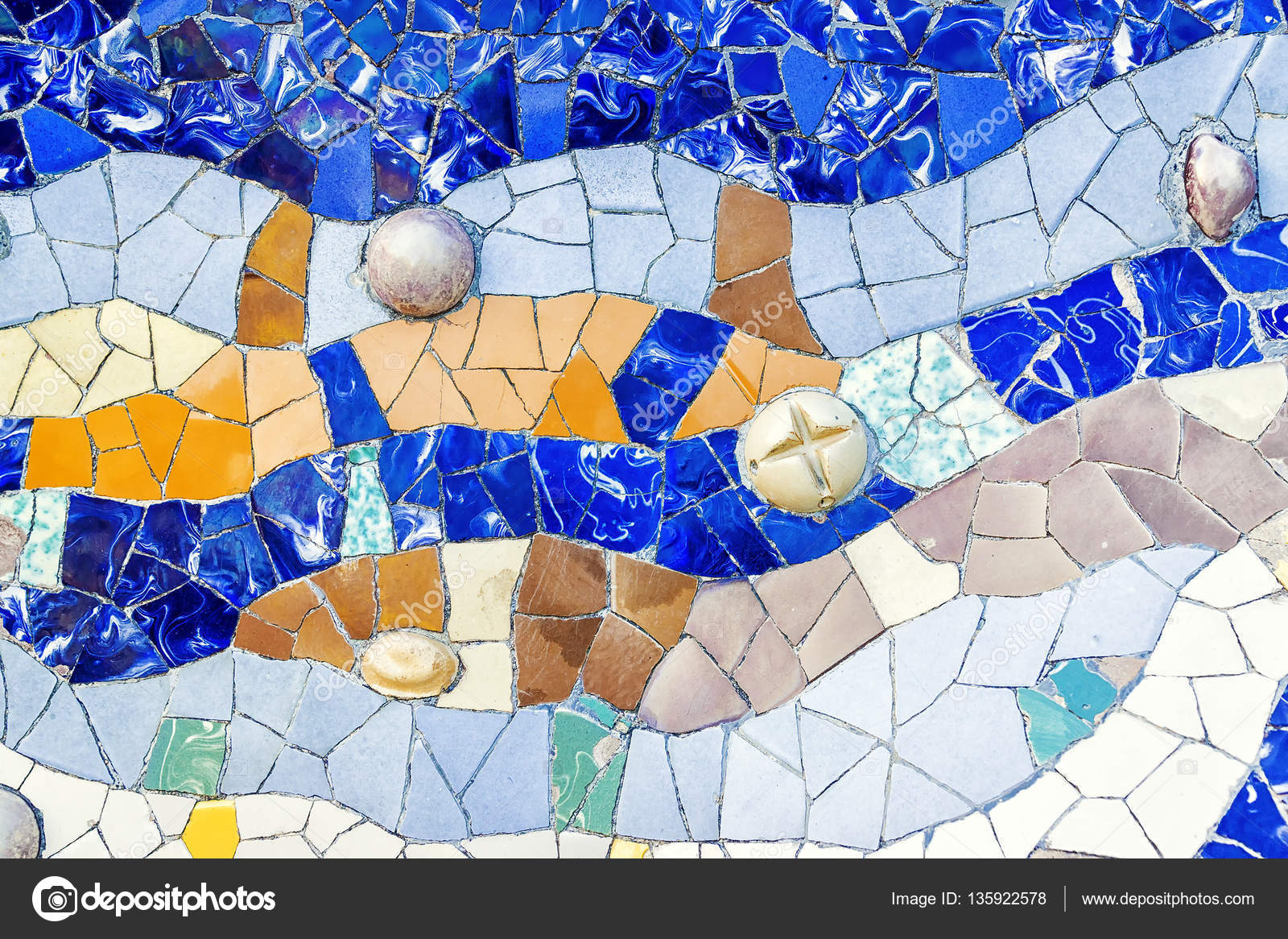 Closeup of mosaic of colored ceramic tile by Antoni Gaudi at his ...