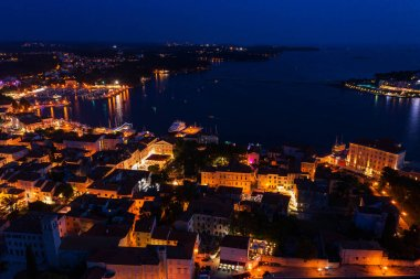 Night city on the coast of the sea. Top view. Shooting from a drone.