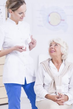 Elder patient and nurse