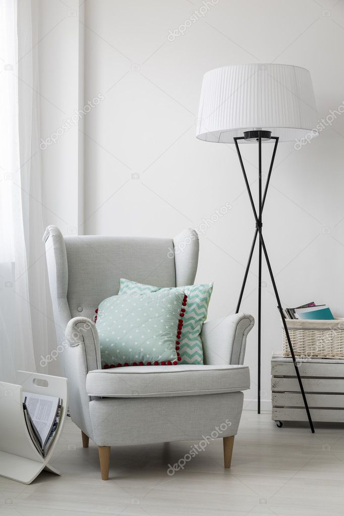 Stylish grey armchair and a floor standing lamp — Stock ...
