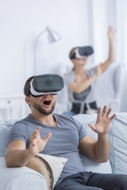 Excited man using 3D glasses