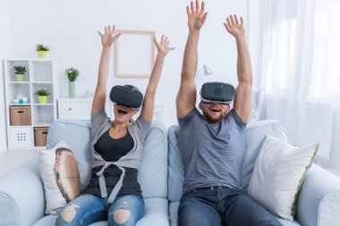 Couple having fun with 3D roller coaster