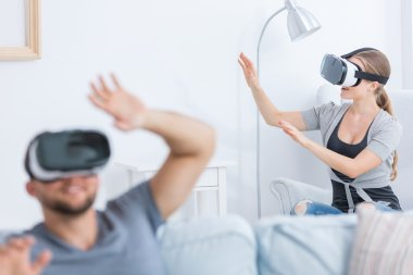 Man and woman using 3D glasses