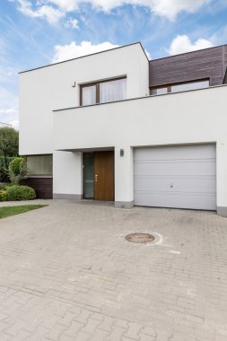 White villa with garage