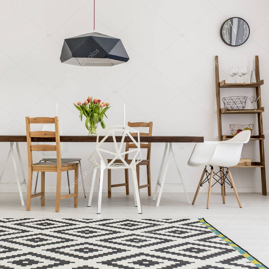 Table and different chairs — Stock Photo © photographee.eu #129673278