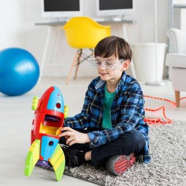 Boy holding a toy rocket