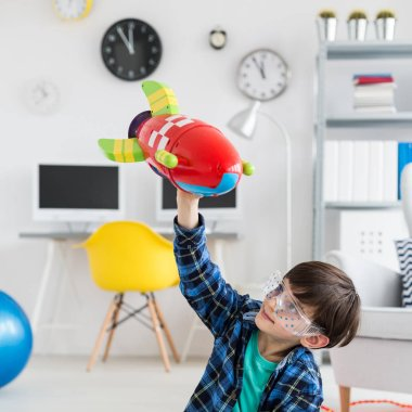 Boy playing with a toy rocket