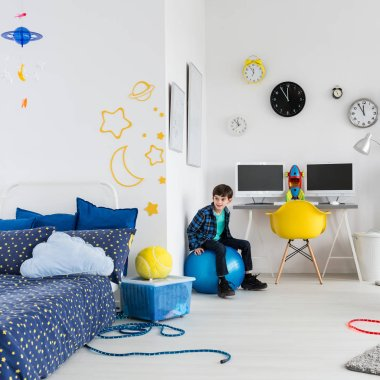 Bboy in his space themed bedroom