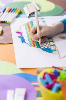Creative boy drawing a