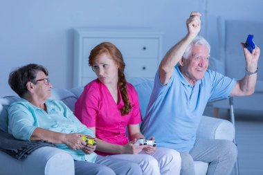 Nursing home residents playing together