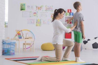 Phsyiotherapist correcting body posture