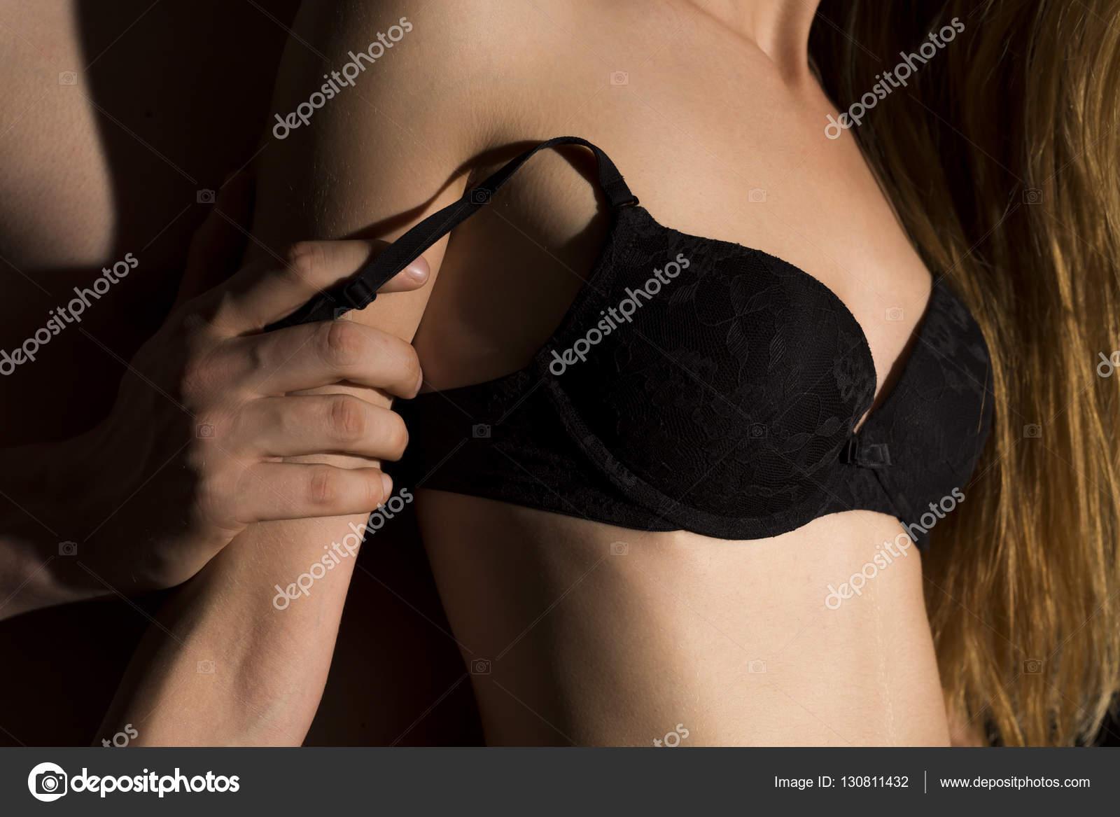 man undressing woman