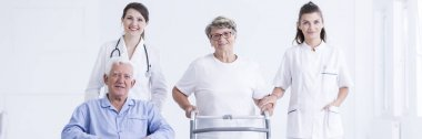 Elderly couple with care asistants