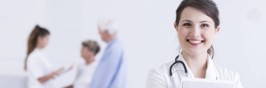 Happy doctor in nursing home
