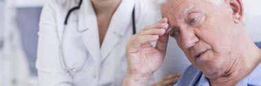 Doctor trying to comfort older man