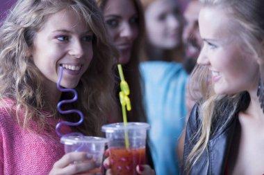 Women drinking cocktails at nightclub