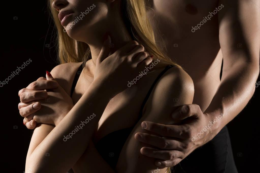 Embracing sensual woman