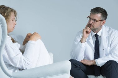 Anxious woman with a psychiatrist