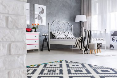 Grey room with pattern carpet