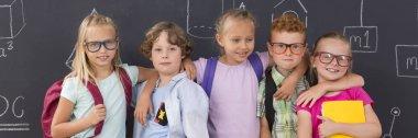Kids standing on chalkboard background