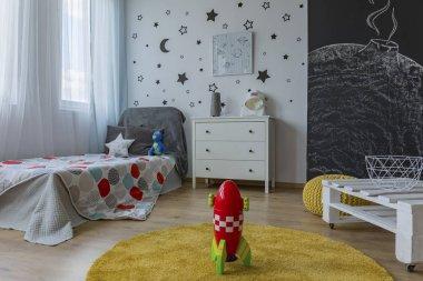 Toy rocket in space bedroom