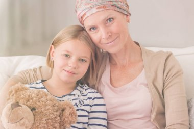 Ill woman embracing child