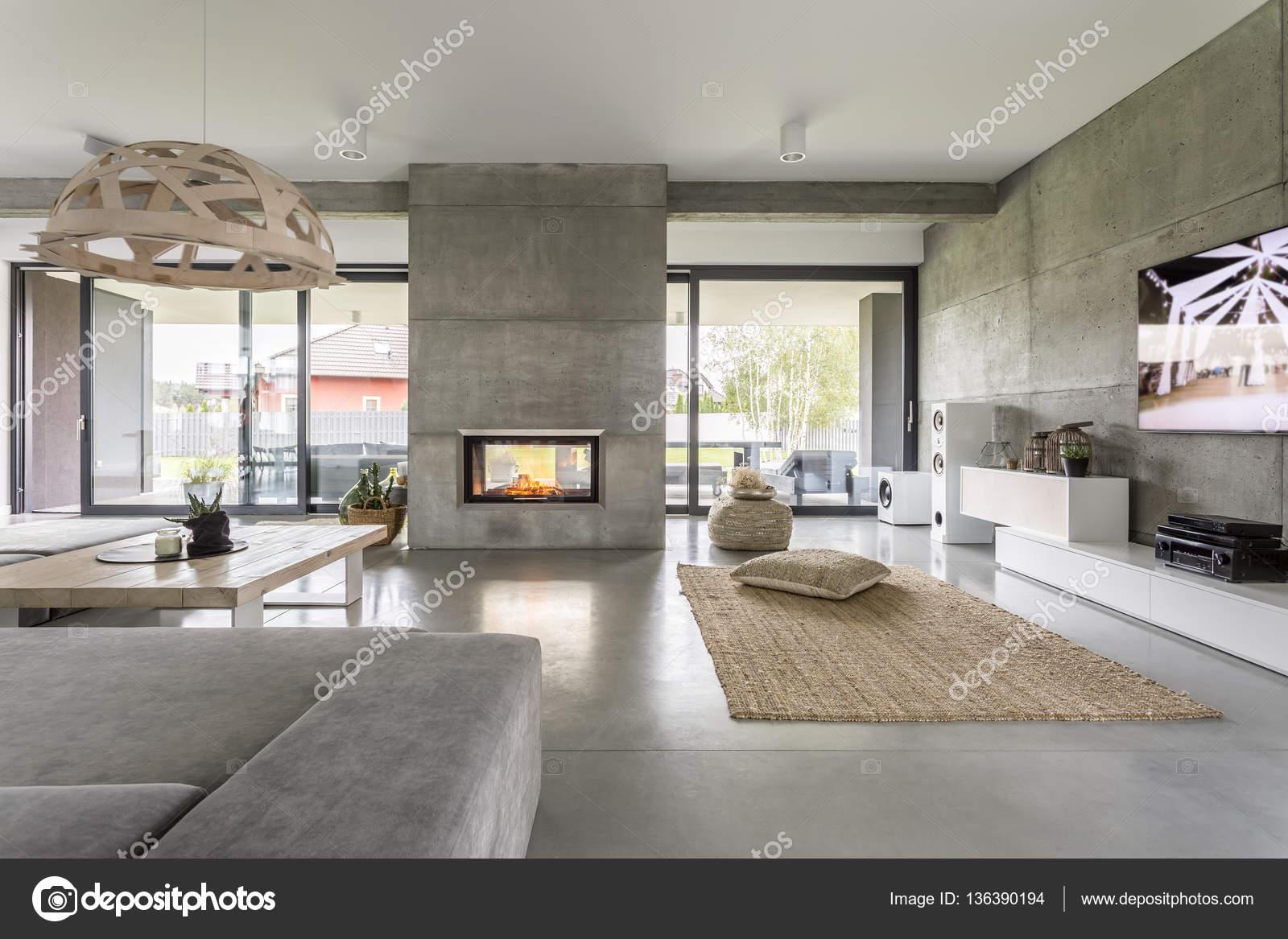 Spacious villa with cement wall stock photo 136390194 - Parete con camino ...