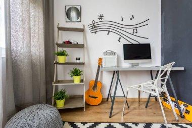 Minimalist scandi room with guitar