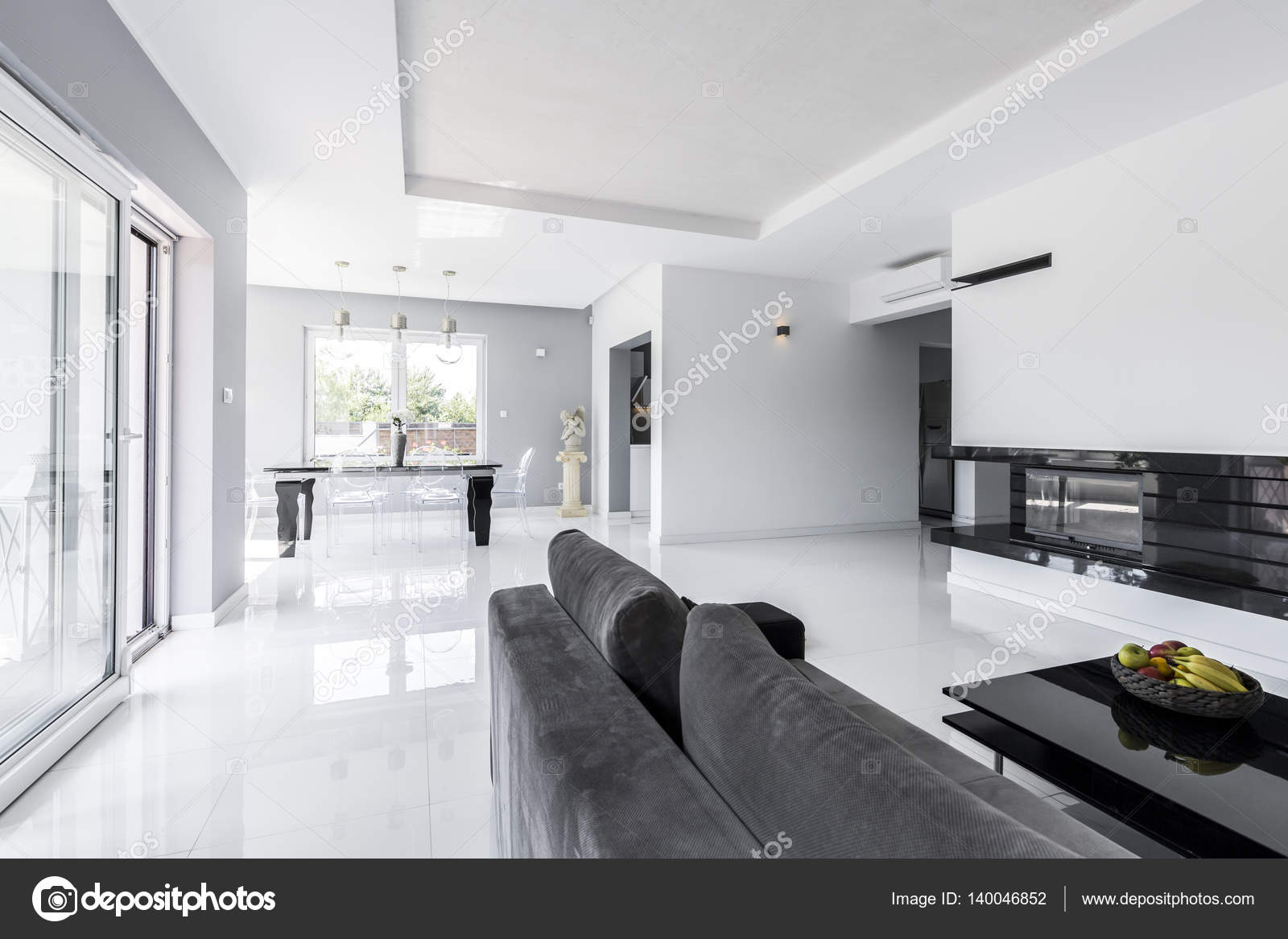 Spacious living room with grey couch — Stock Photo © photographee.eu ...