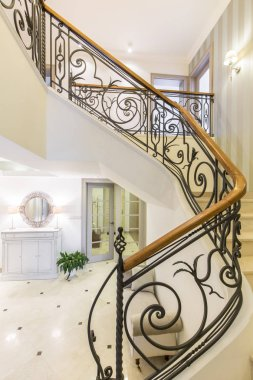Marble stairs with elegant forged handrail
