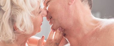 Senior couple kissing each other