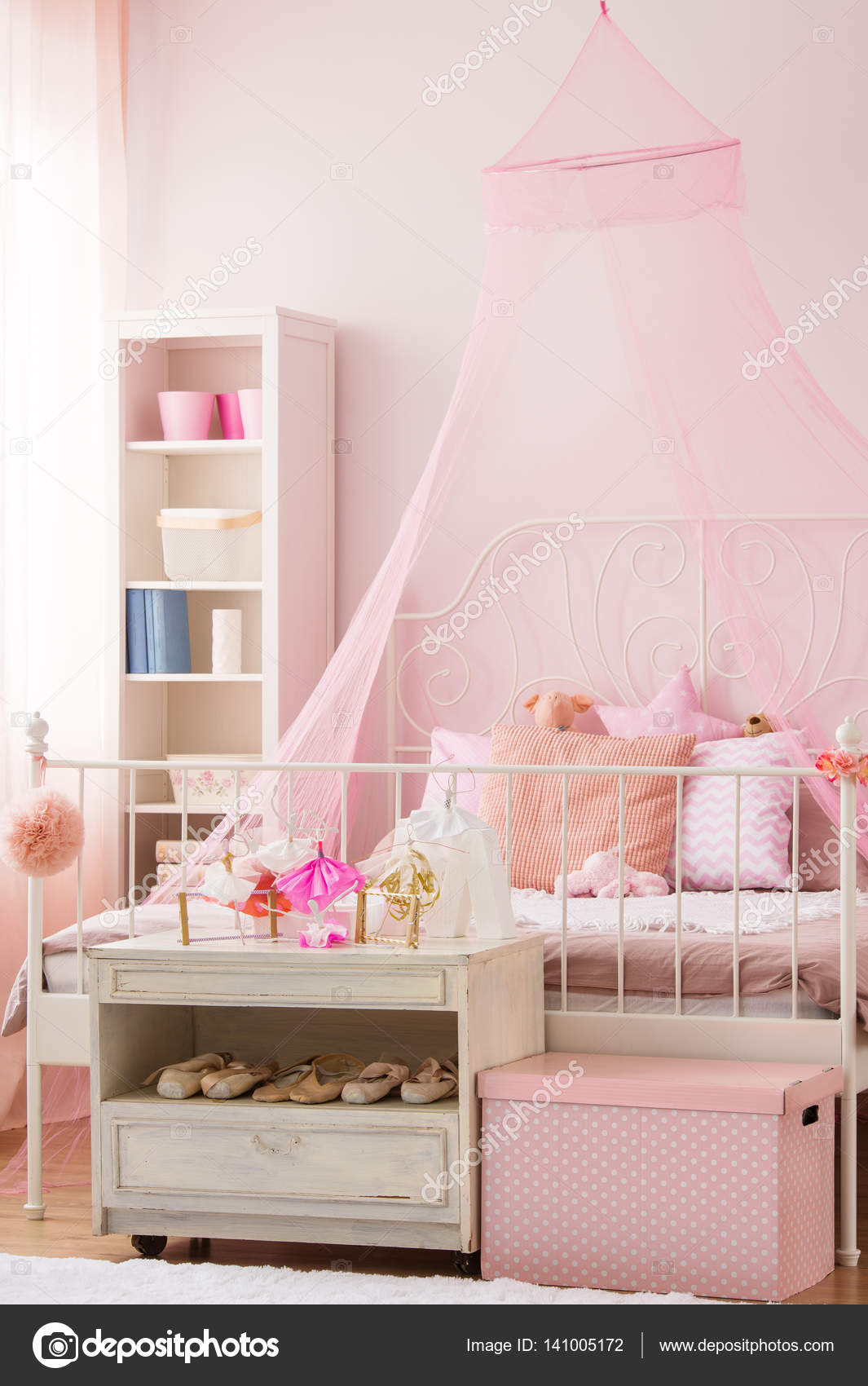 Girls bedroom with canopy bed stock photo