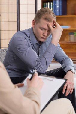 Man meeting psychologist