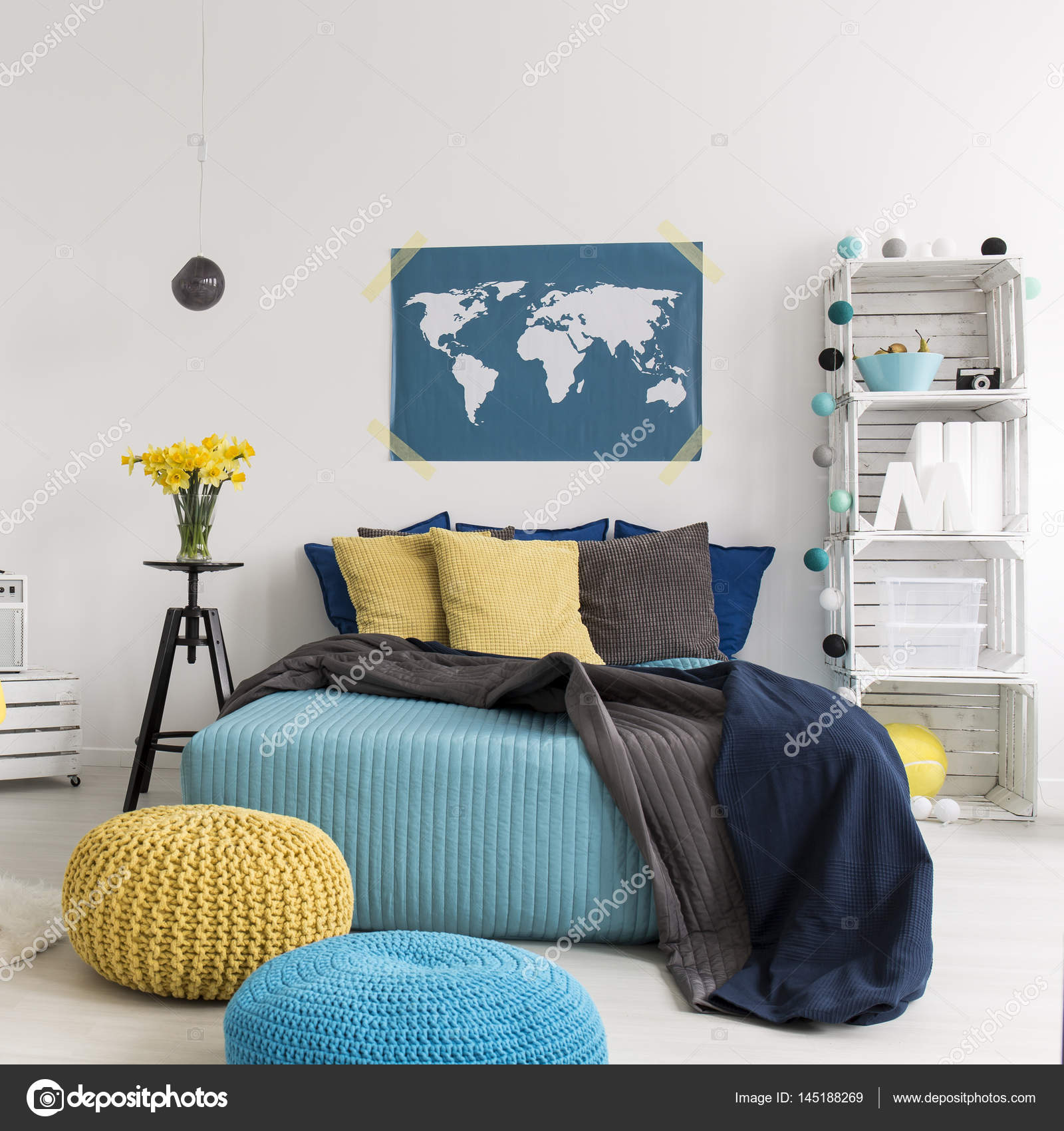 Bedroom with bed and diy bookcase stock photo photographee world map on the wall in modern bedroom with bed pillows and diy hipster bookcase photo by photographee gumiabroncs Image collections