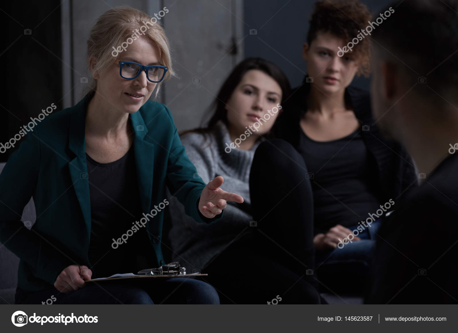 Rehabilitation Counselor And His Patients Stock Photo