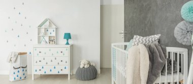 Childs room with white cot
